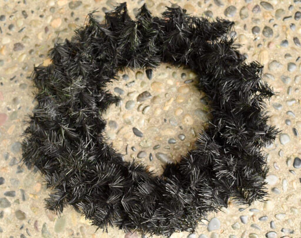 pine wreath painted black