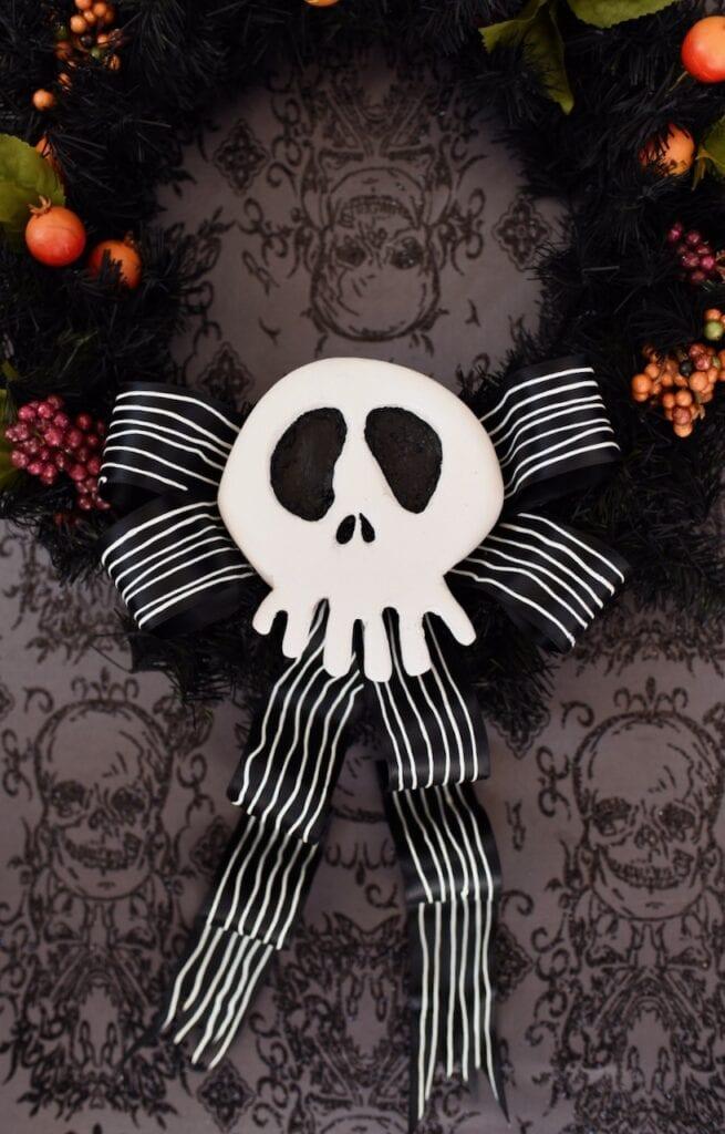 white Jack Skellington skull with black bow on wreath