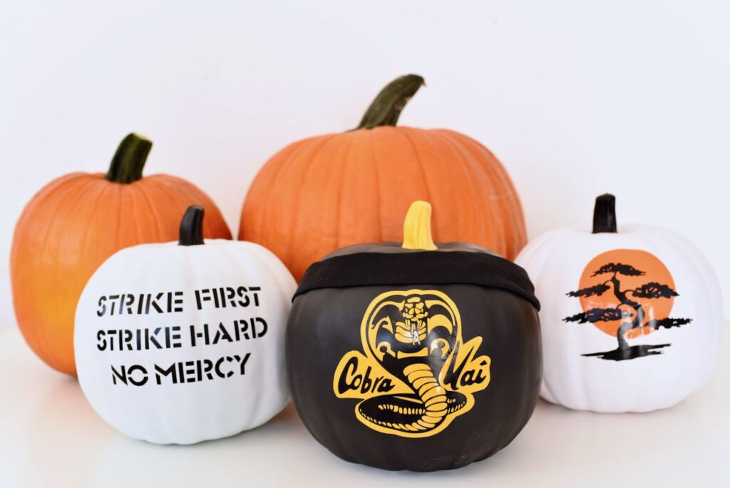 Halloween pumpkins with Cobra Kai logo