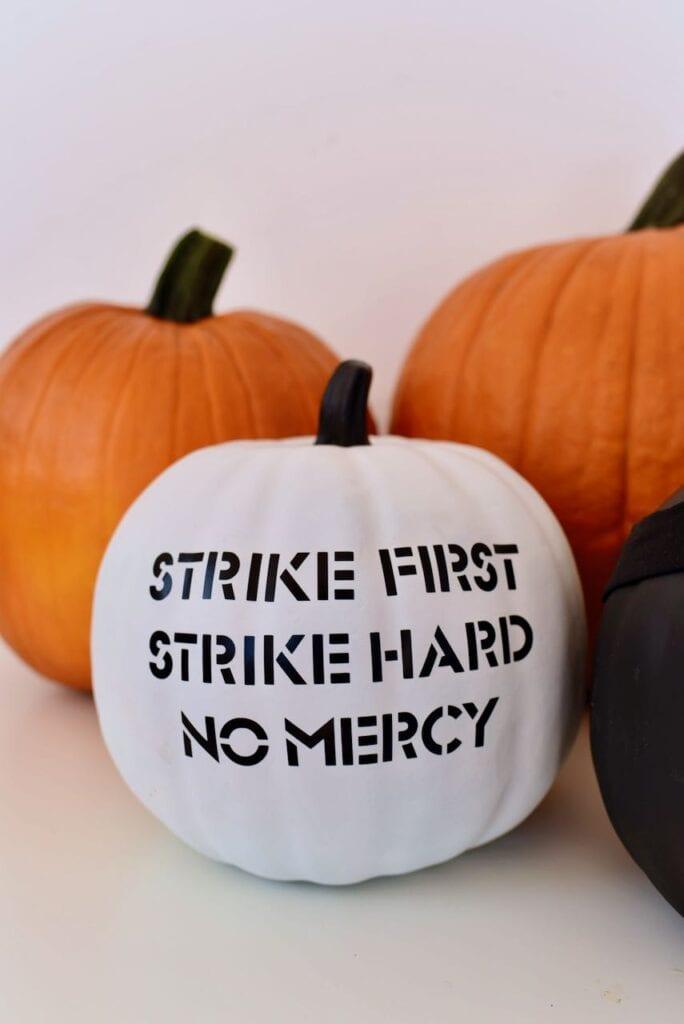 White pumpkin with black words