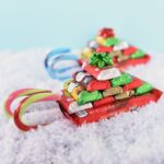 candy sleigh with mini candy bars stacked on candy bar and candy canes