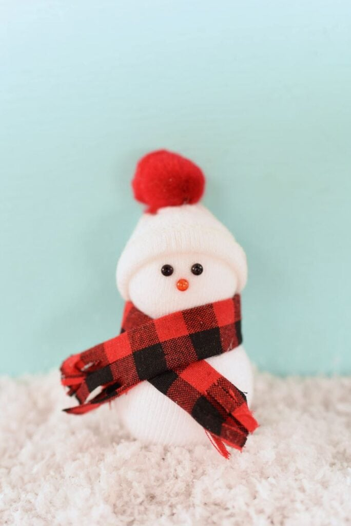 diy snowman christmas ornament in snow