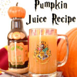 pumpkin juice in Harry Potter glass on books