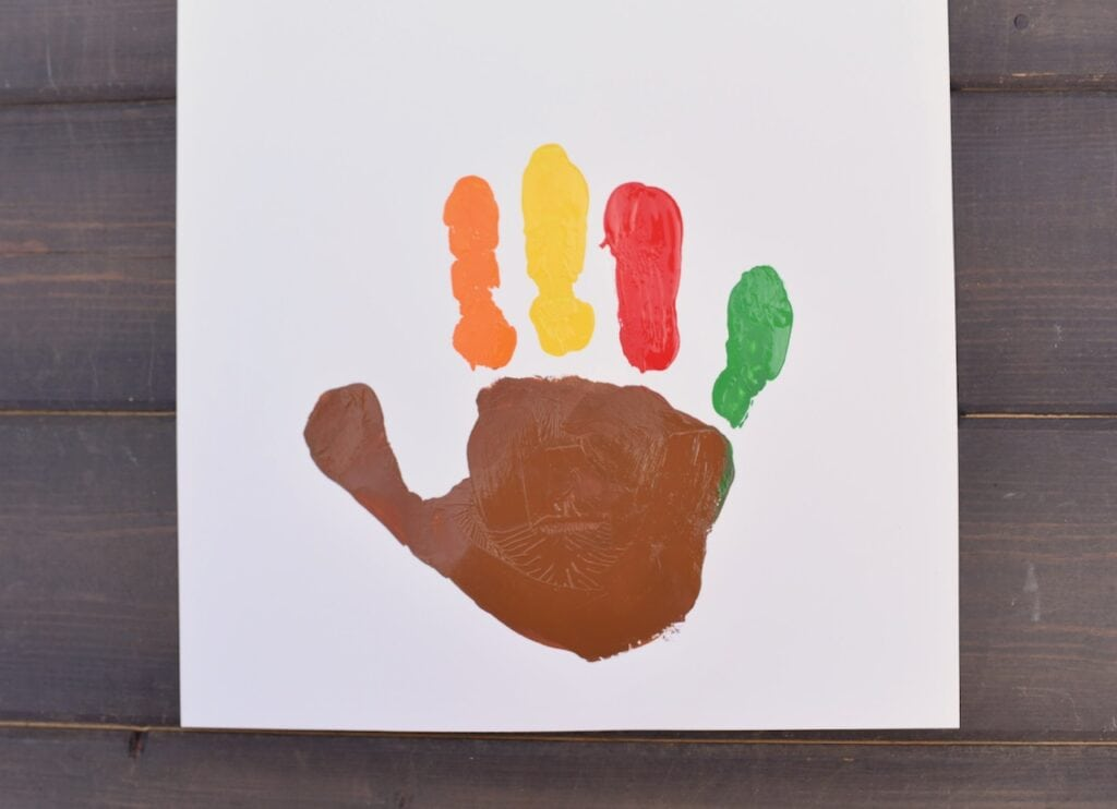 painted handprint that looks like a turkey
