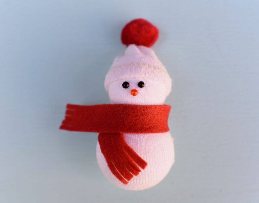 Small snowman with red scarf and hat