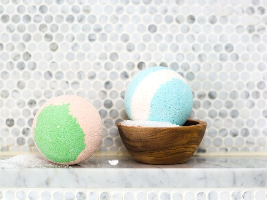 two bath bombs on tile in bathroom