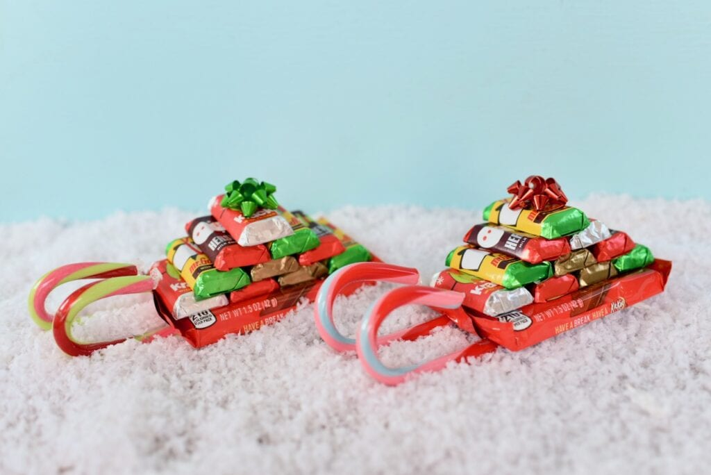 two candy sleighs in snow