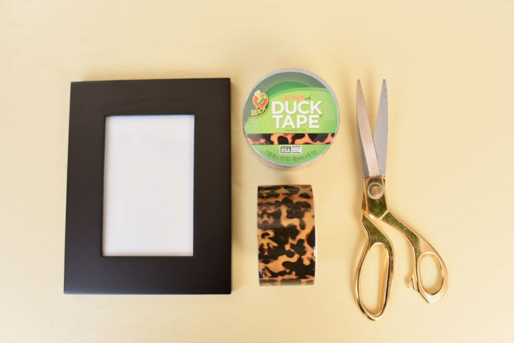 picture frame, duck tape, and scissors