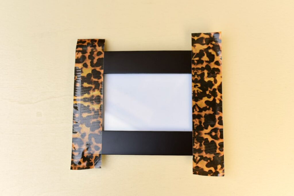two pieces of duck tape on picture frame