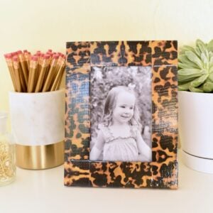 girl's photo in picture frame with duct tape