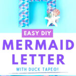 mermaid letter with scallops and shells