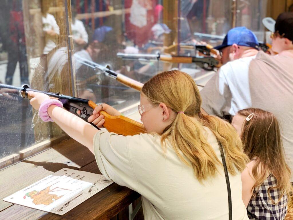 girl shooting BB gun