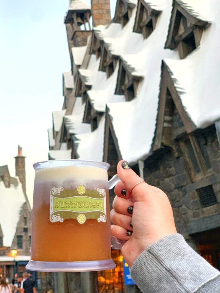 hand holding butterbeer in cup