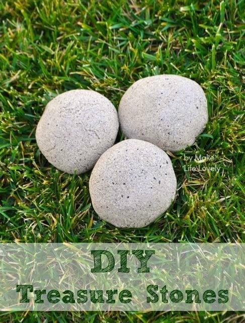 three round stones in grass