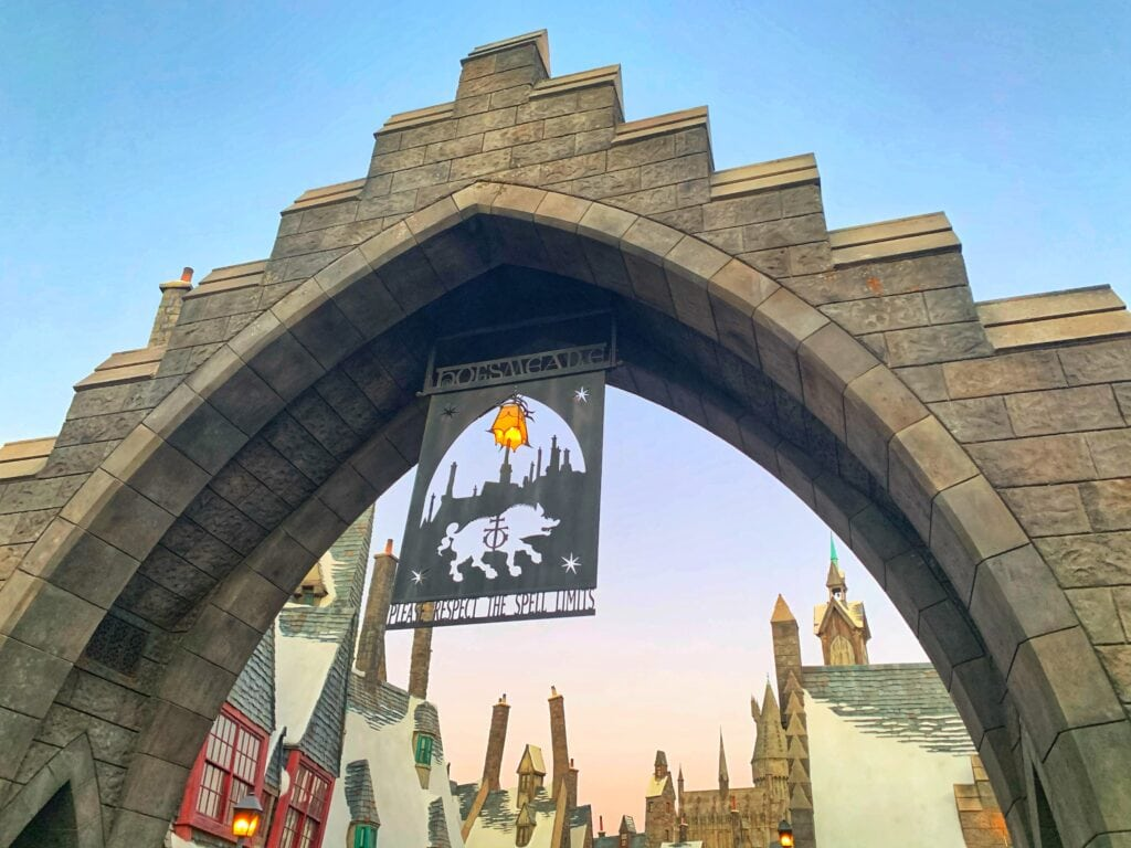 Hogsmeade sign by buildings with snow