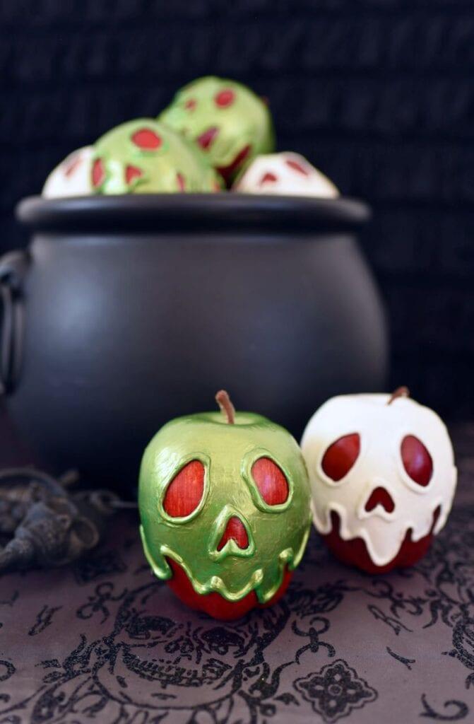 poison apples next to black cauldron