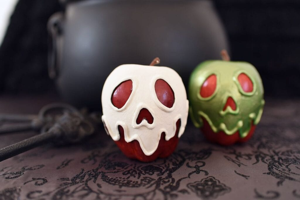 white and green apples with faces