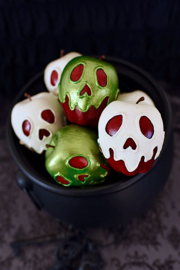 cauldron with green and white poison apples